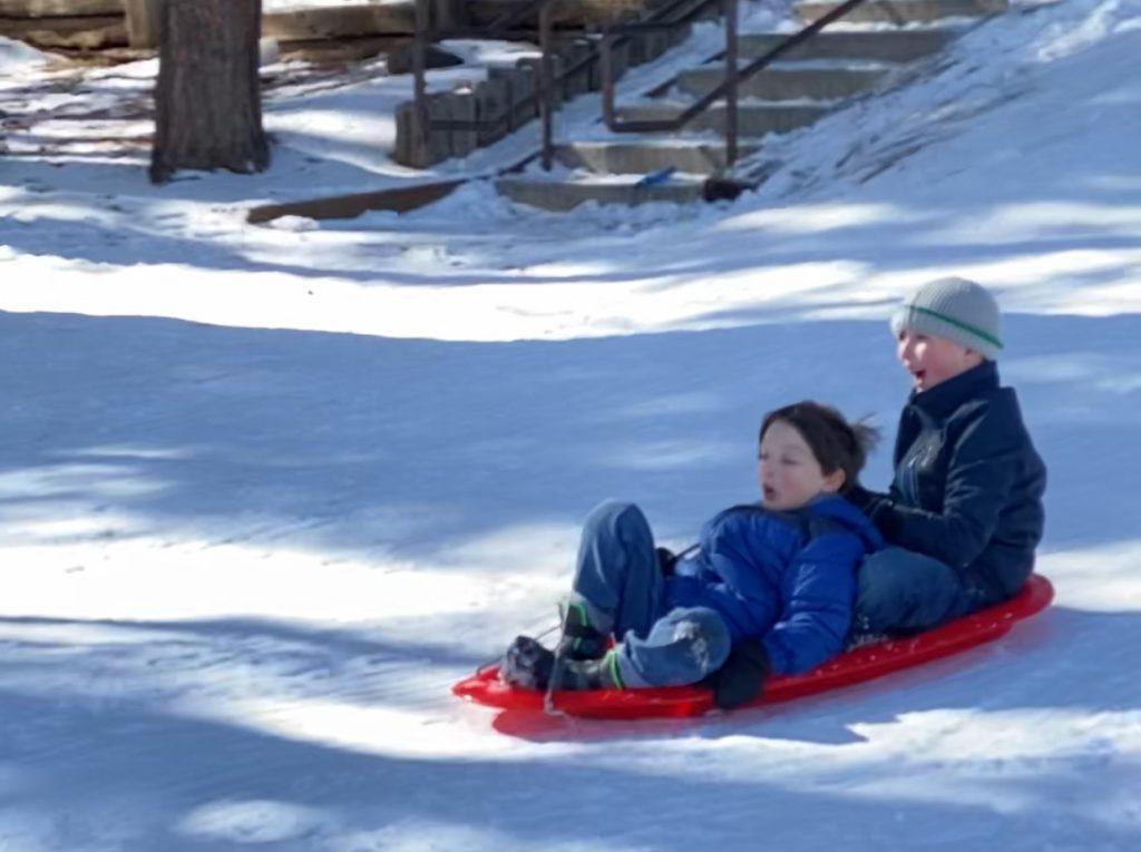 two boys sledding