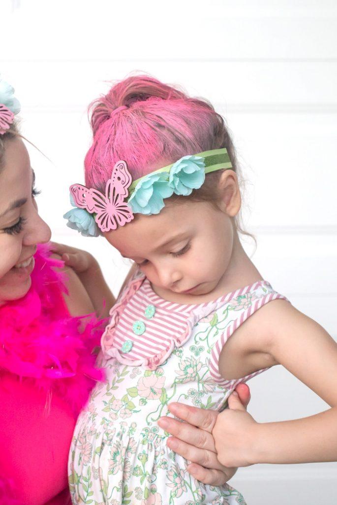 girl with pink sprayed hair and trolls inspired headband