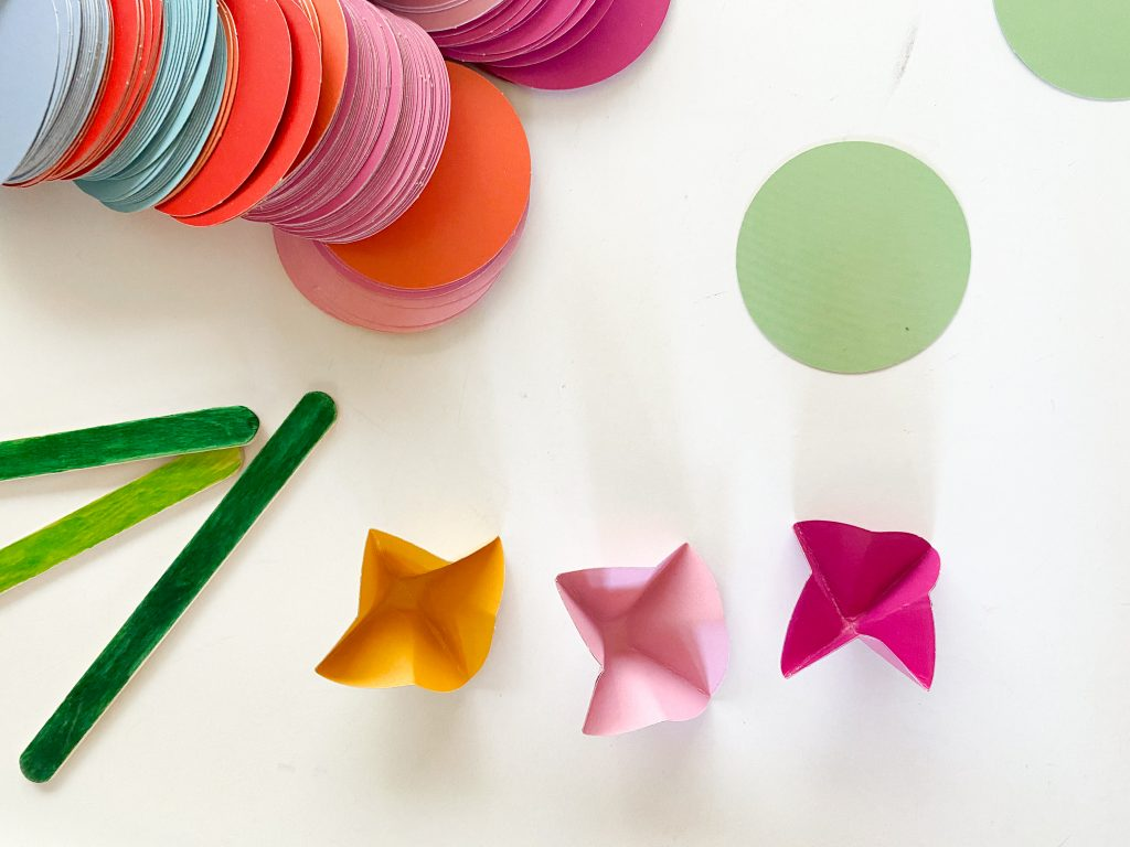 circle paint chips with green wooden sticks and paper flowers