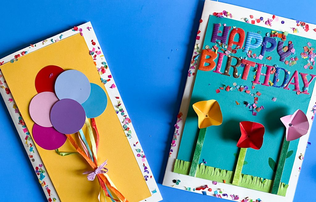 Easy DIY Greeting Card tutorial using cardstock, circle paint chips, Popsicle sticks, and markers.