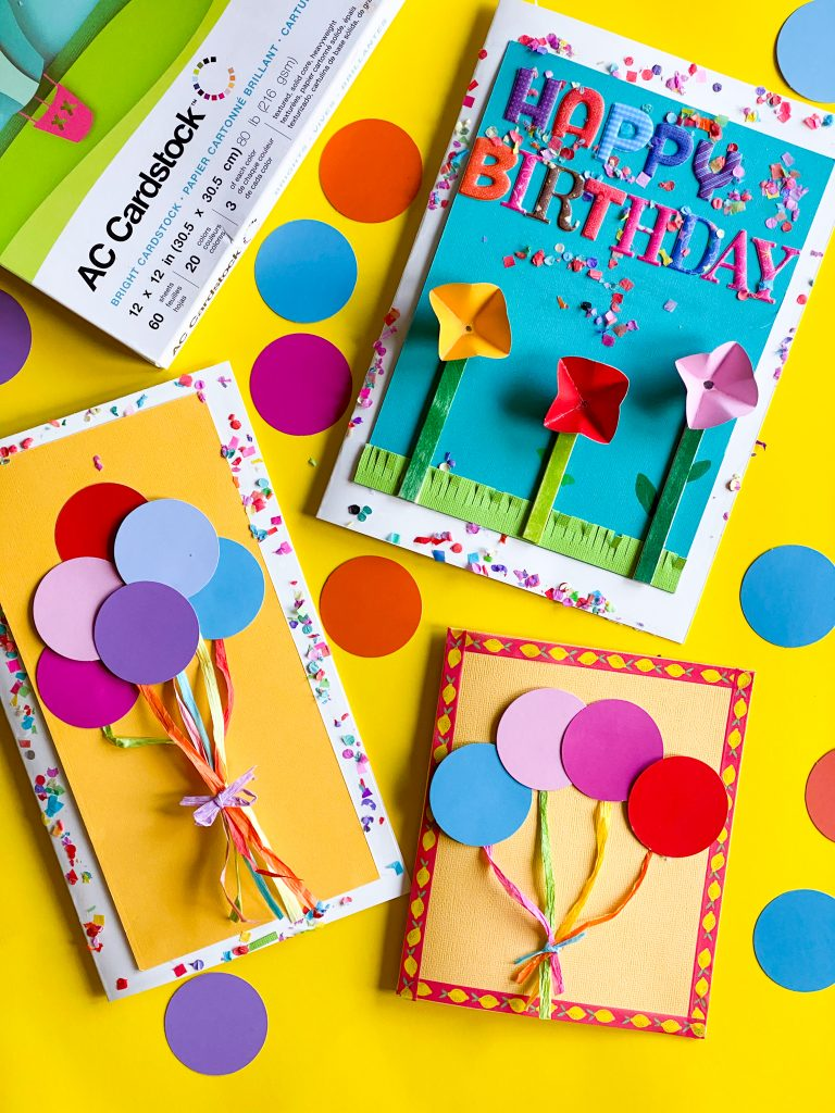 3 colorful greeting cards on yellow background