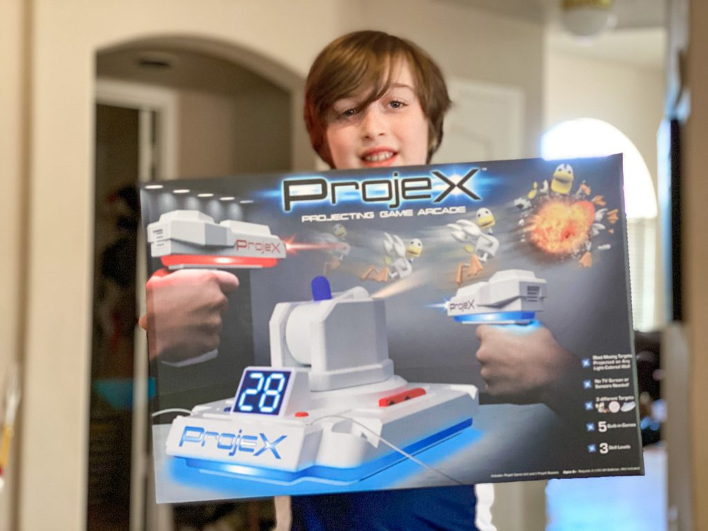 boy holding Projex laser toy in a box