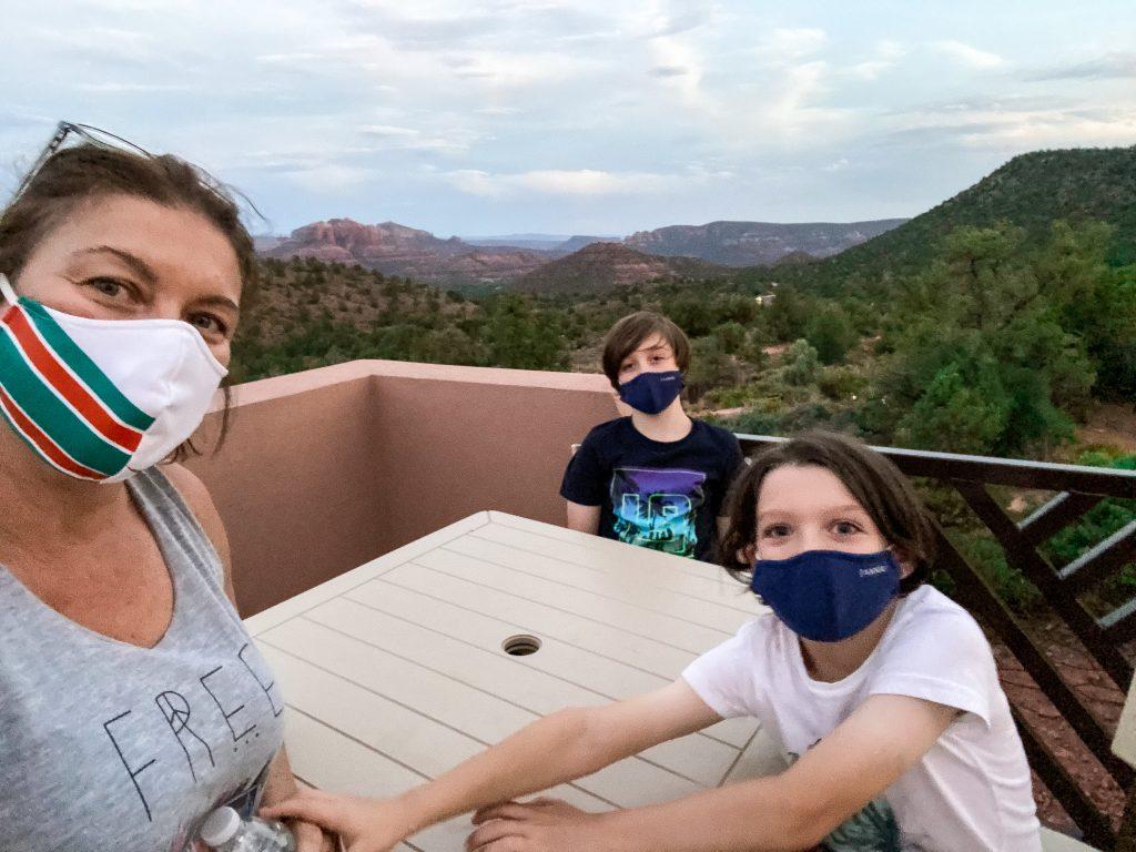 family wearing masks outside