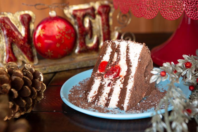 slice of black forest cake on blue plate