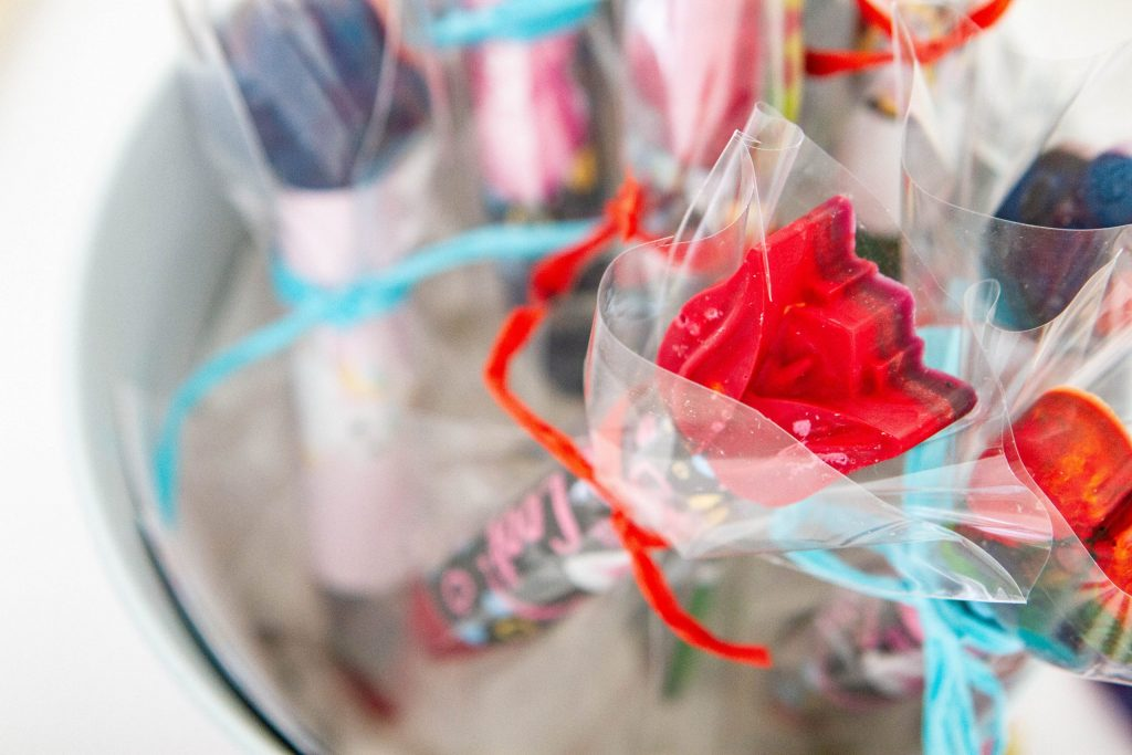 pretty crayon flower wrapped in plastic and raffia