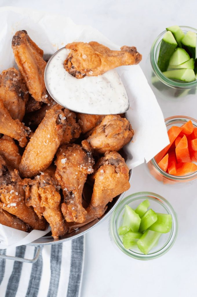 chicken wings with ranch dressing , carrots and celery