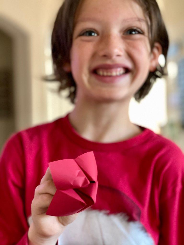 boy holding fortune teller