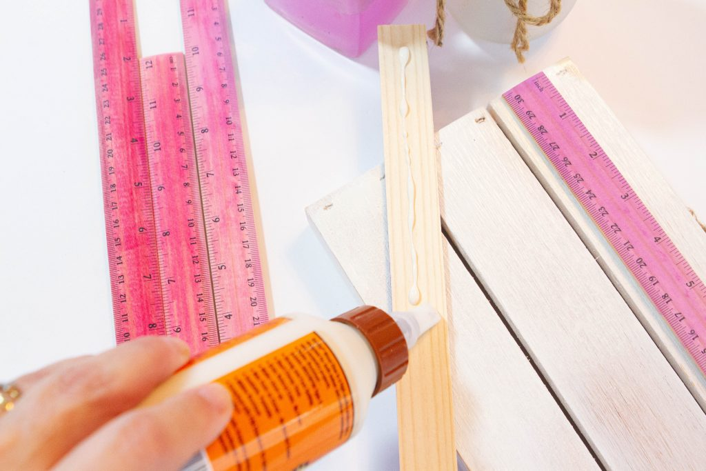 applying glue to wood rulers