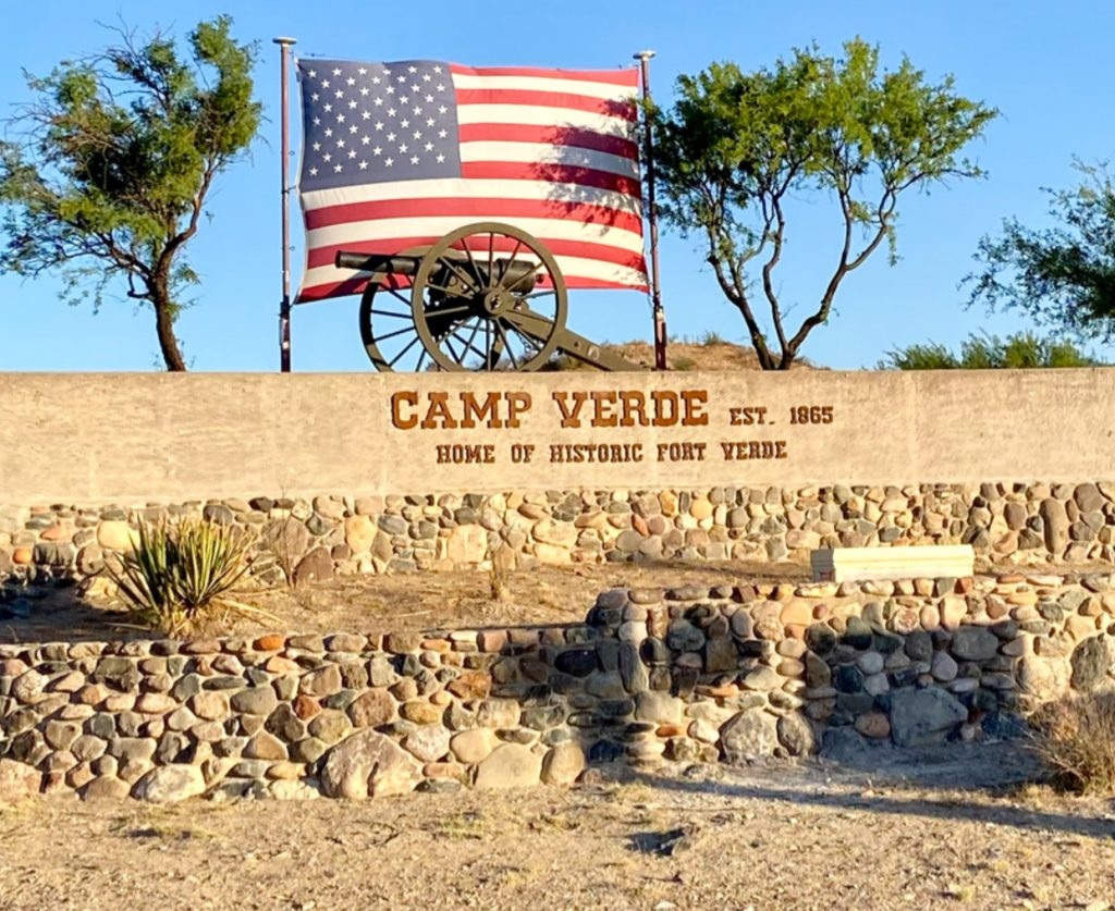 Camp Verde sign with American Fl