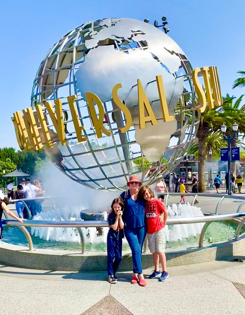 family standing outside Universal Signs