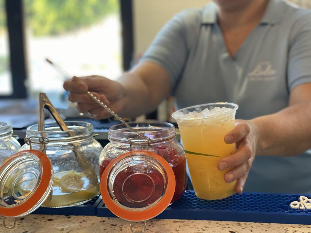 bartender adding cherry to drink