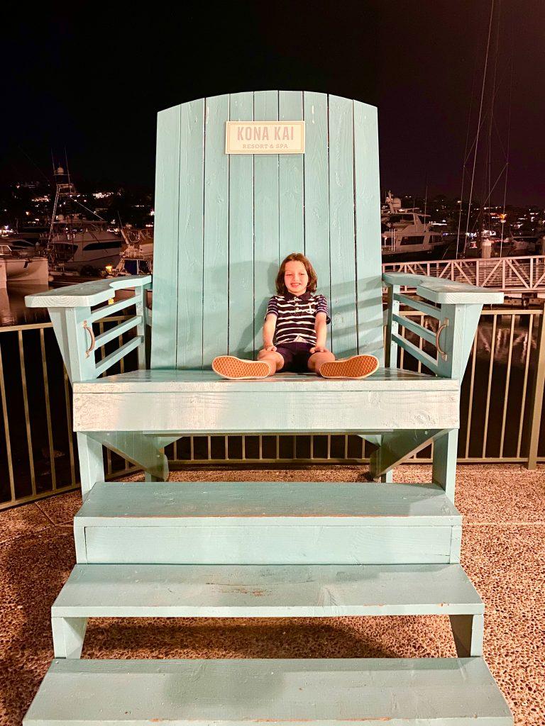 blue beach chair with boy