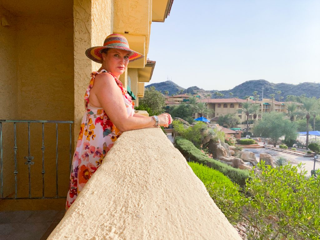 woman on balcony at The Pointe Hilton Tapatio Cliffs Resort