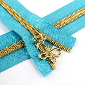#5-Nylon-Coil-Zipper-turquoise-with-gold-teeth-butterfly-pulls