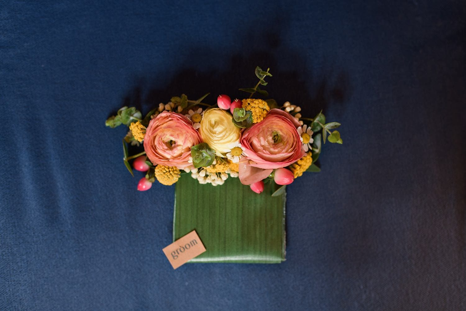 peach and pink pocket boutonniere
