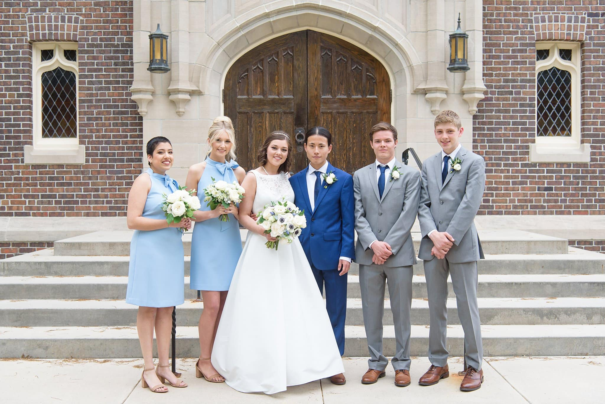 bridal party photos at grinnell college in front of herrick chapel