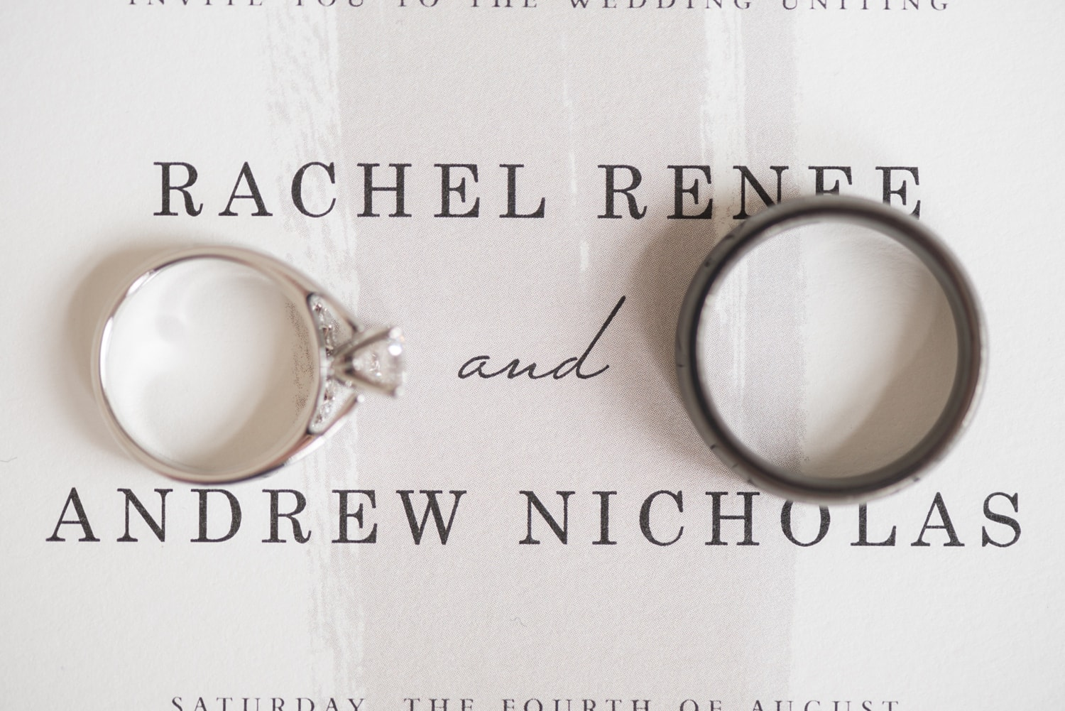 close up photo of bride and grooms wedding rings