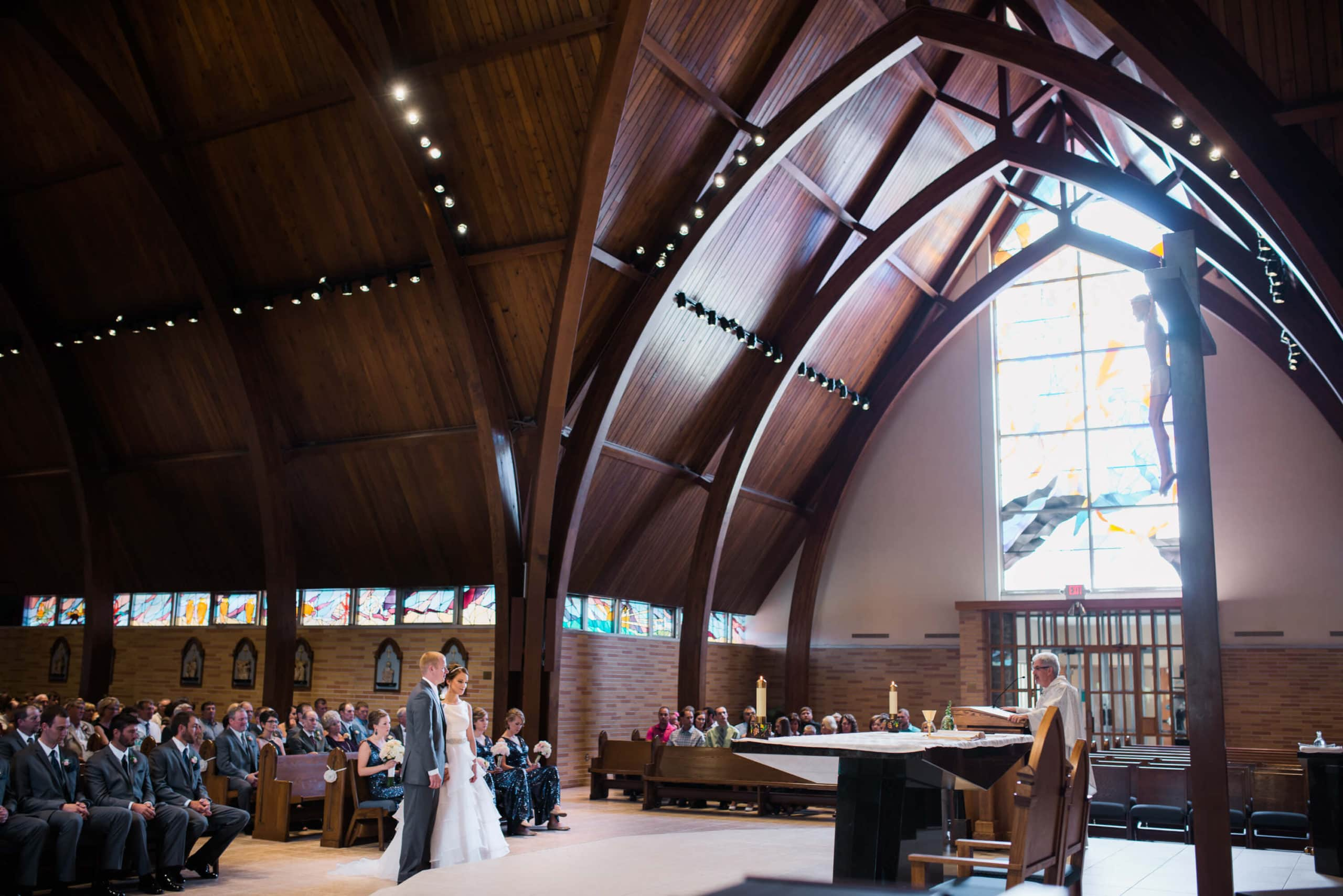 bride and groom standing at the altar for a catholic wedding ceremony