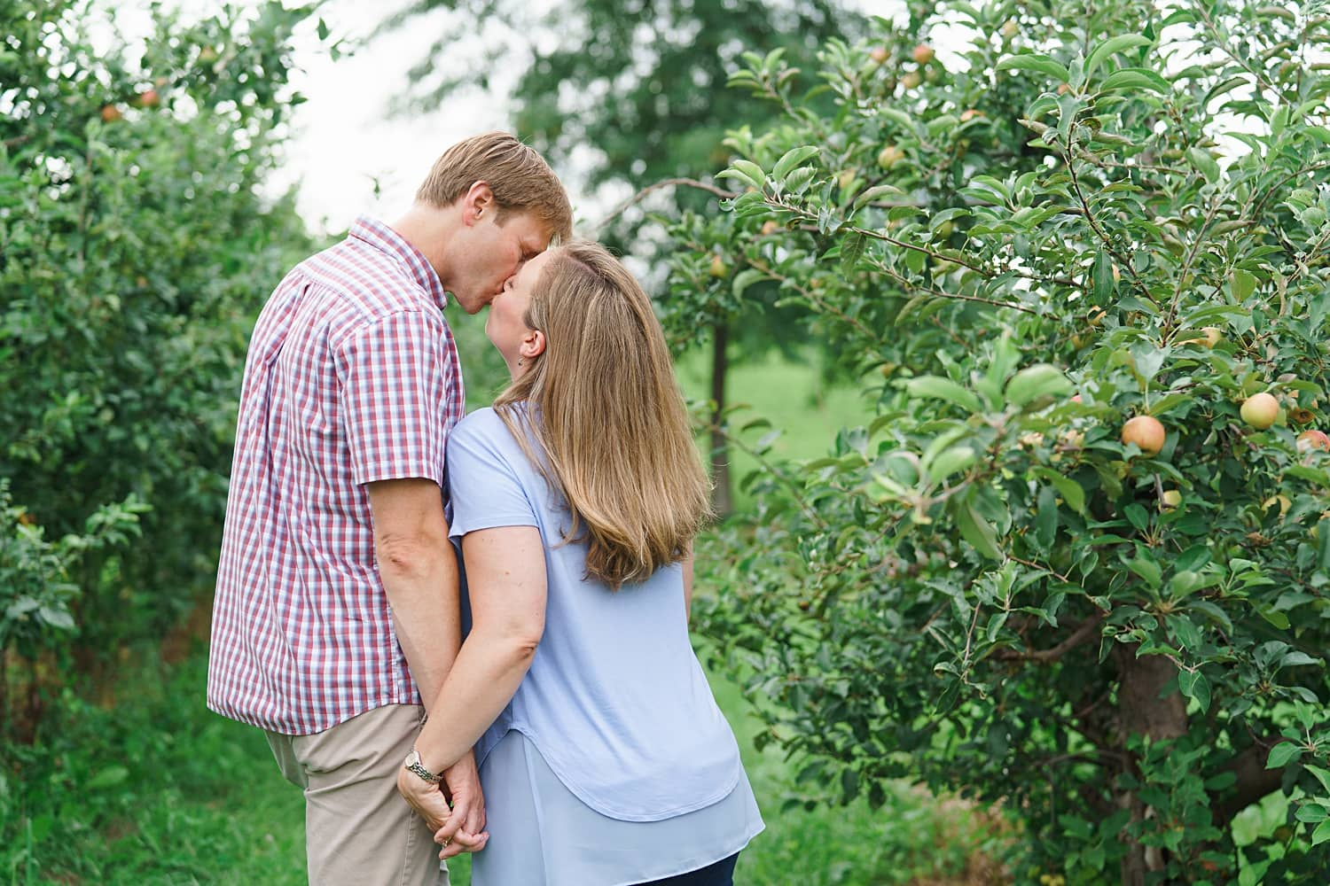 engagement photos at apple orchard in iowa