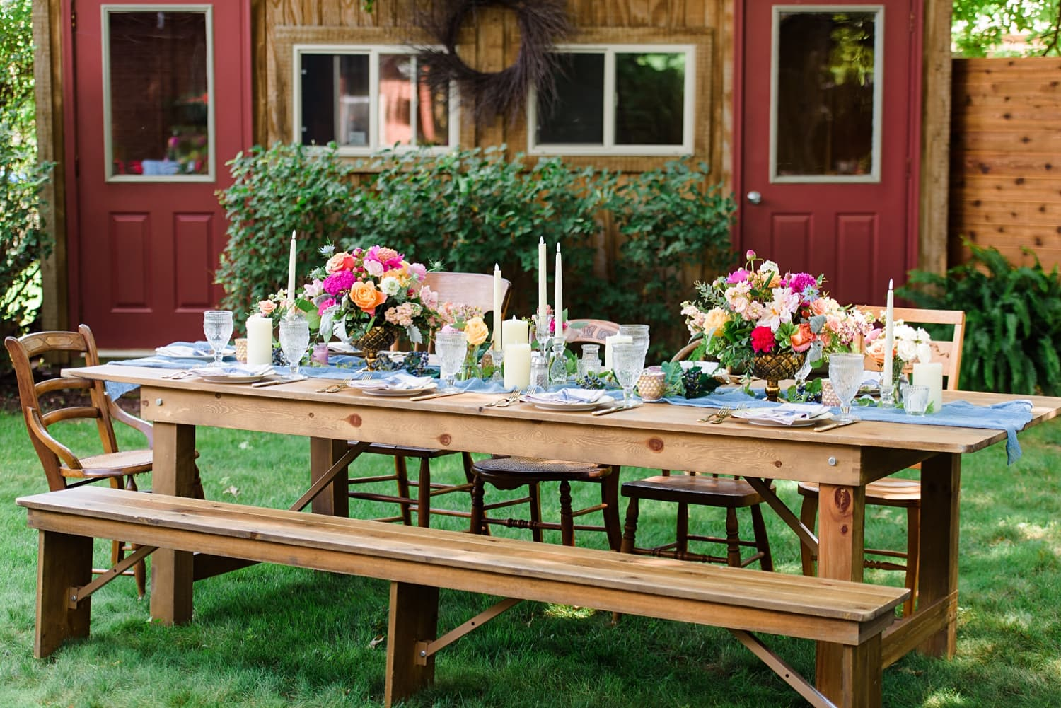 farmhouse tables with colorful floral centerpiece and table runner