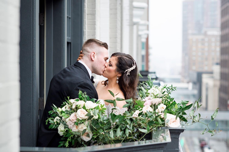 Des Moines tea room balcony wedding photo