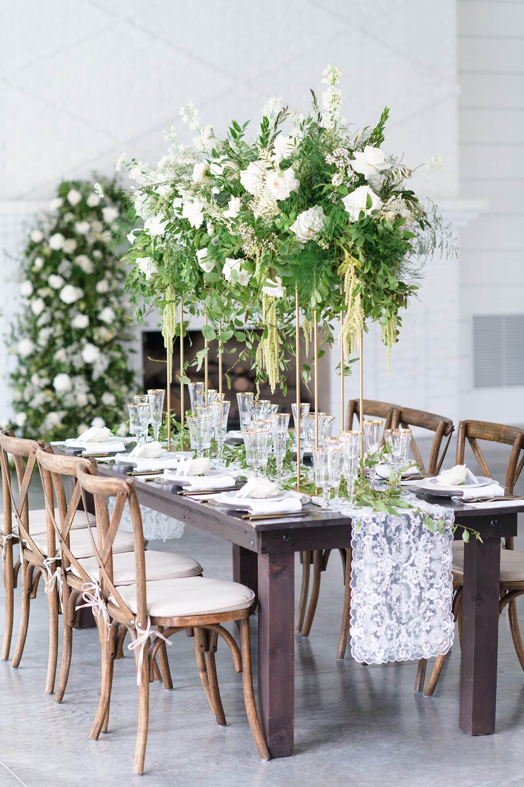 tall floral reception table