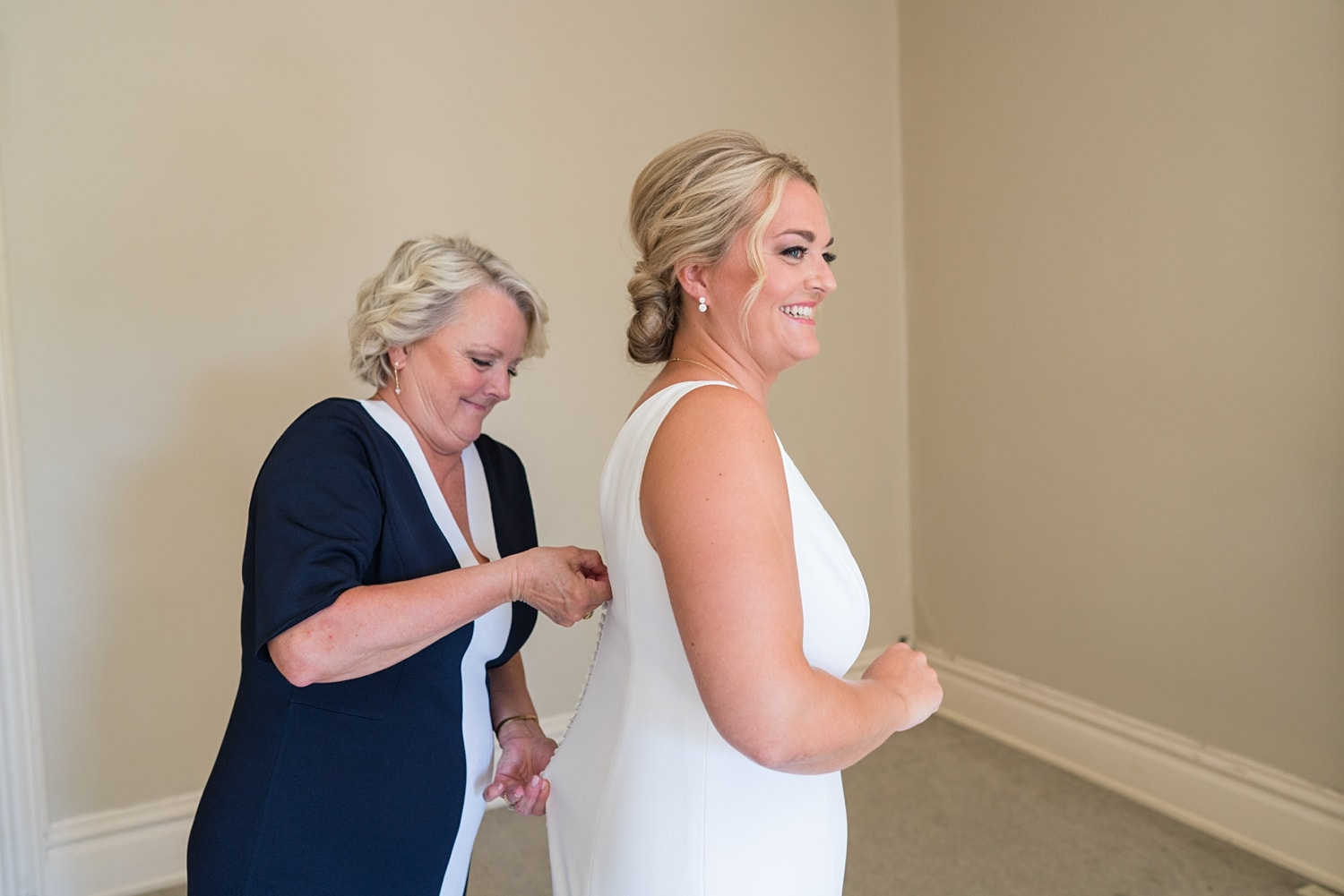 mom buttoning up the dress