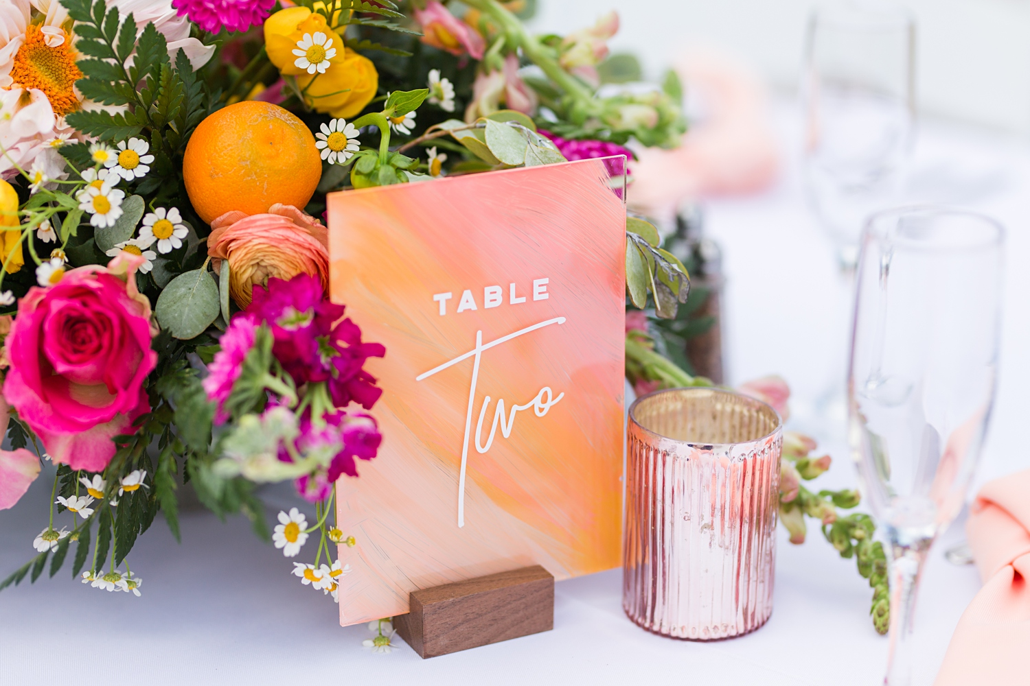 hand painted table number with reds and pinks and oranges