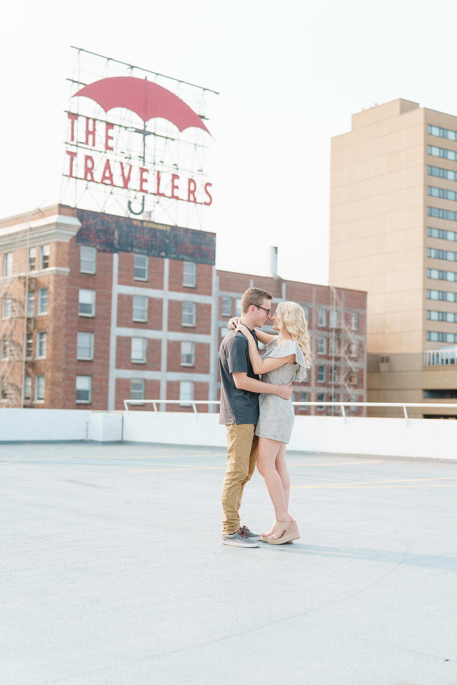 the travelers sign engagement photos