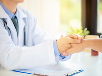 Source: freepik; Copyright: jcomp; URL: https://www.freepik.com/free-photo/friendly-man-doctor-s-hands-holding-male-patient-s-hand-encouragement-empathy_5017998.htm#page=1&query=patient%20talking%20to%20doctor&position=19; License: Licensed by JMIR.