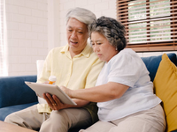 Source: Freepik; Copyright: tirachardz; URL: https://www.freepik.com/free-photo/asian-elderly-couple-using-tablet-search-medicine-information-living-room-couple-using-time-together-while-lying-sofa-when-relaxed-home_4396326.htm; License: Licensed by JMIR.