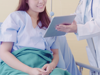 Source: Freepik; Copyright: tirachardz; URL: https://www.freepik.com/free-photo/beautiful-smart-asian-doctor-patient-discussing-explaining-something-with-tablet_4014708.htm; License: Licensed by JMIR.