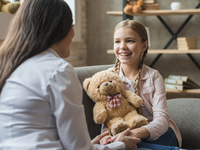 Source: Freepik; Copyright: Freepik; URL: https://www.freepik.com/free-photo/female-psychologist-talking-with-girl-holding-teddy-bear-during-therapy-session_3706662.htm; License: Licensed by JMIR.