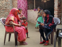 Enumerator interviewing a respondent using a tablet. Source: Image created by the authors; Copyright: The Authors; URL: http://www.researchprotocols.org/2020/8/e17619/; License: Licensed by JMIR.