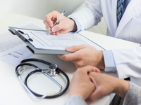 Source: freepik; Copyright: freepik; URL: https://www.freepik.com/free-photo/close-up-doctor-filling-medical-form-with-patient_3894250.htm#page=1&query=doctors%20talking%20with%20patient&position=1; License: Licensed by JMIR.