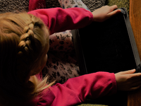 Child engaged with a communication device. Source: Image created by the Authors; Copyright: Heidi Holmen; URL: http://www.jmir.org/2020/2/e16248/; License: Licensed by JMIR.