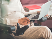 Source: iStock by Getty Images; Copyright: fotostorm; URL: https://www.istockphoto.com/ca/photo/disabled-woman-using-laptop-gm1079012536-289114455; License: Licensed by the authors.