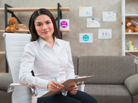 Source: Freepik; Copyright: freepik; URL: https://www.freepik.com/free-photo/portrait-smiling-female-psychologist-sitting-white-chair-with-clipboard-pencil-her-office_3706756.htm; License: Licensed by JMIR.