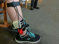 Haptic Bracelets attached to lower limbs of participant living with Huntington's Disease. Source: Image created by the Authors; Copyright: The Authors; URL: http://rehab.jmir.org/2020/2/e18589/; License: Creative Commons Attribution + Noncommercial + NoDerivatives (CC-BY-NC-ND).