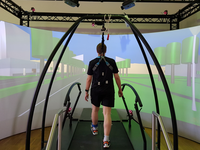 A participant walking through the virtual environment in the Gait Real-Time Analysis Interactive Lab (GRAIL). Source: Image created by authors; Copyright: The Authors; URL: https://games.jmir.org/2020/4/e18455; License: Creative Commons Attribution (CC-BY).