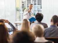 Medical educator and students. Source: iStock by Getty Images; Copyright: skynesher; URL: https://www.istockphoto.com/ca/photo/mid-adult-doctor-teaching-on-a-seminar-in-a-board-room-gm1006430612-271624542; License: Licensed by the authors.