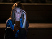 Source: Freepik; Copyright: Dragana_Gordic; URL: https://www.freepik.com/free-photo/closeup-side-view-portrait-young-sad-thoughtful-woman-leaning-against-street-lamp-night-bokeh-copy-space-background-upset-young-woman-with-mobile-phone-reads-message_1162701.htm; License: Licensed by JMIR.