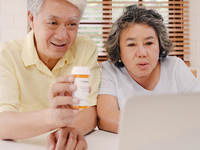Source: freepik; Copyright: tirachardz; URL: https://www.freepik.com/free-photo/asian-elderly-couple-using-laptop-conference-with-doctor-about-medicine-information-living-room-couple-using-time-together-while-lying-sofa-home_4396355.htm; License: Licensed by JMIR.