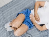 Source: Freepik; Copyright: freepik; URL: https://www.freepik.com/free-photo/overhead-view-man-wearing-sock-lying-bed-suffering-from-stomach-pain_3614446.htm; License: Licensed by JMIR.