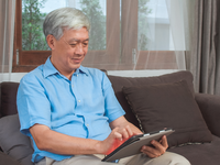 Source: Freepik; Copyright: tirachardz; URL: https://www.freepik.com/free-photo/asian-senior-men-using-tablet-home-asian-senior-chinese-male-search-information-about-how-good-health-internet-while-lying-sofa-living-room-home-concept_5820825.htm; License: Licensed by JMIR.