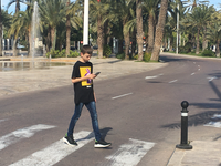A smombie walking on a zebra crossing. Source: image created by the authors; Copyright: The Authors; URL: http://www.jmir.org/2020/8/e19350; License: Creative Commons Attribution (CC-BY).