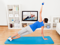 Telerehabilitation after knee or hip replacement. Source: iStock by Getty Images; Copyright: AndreyPopov; URL: https://www.istockphoto.com/ca/photo/woman-exercising-on-yoga-mat-in-front-of-tv-gm465643115-33352532; License: Licensed by the authors.