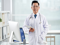 Source: freepik; Copyright: pressfoto; URL: https://www.freepik.com/free-photo/confident-doctor-looking-camera-holding-tablet-pc_5698717.htm#page=1&query=asian+doctor+computer&position=4; License: Licensed by JMIR.