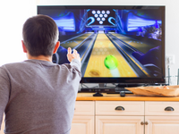 Source: Adobe Stock; Copyright: Cheshka; URL: https://stock.adobe.com/ca/images/a-man-playing-video-game-without-joystick-at-home-cheerful-father-with-family-playing-bowling-and-having-fun-with-new-trends-technology-gaming-concept/257663384?asset_id=257663384; License: Licensed by JMIR.