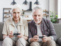 Untitled. Source: freepik; Copyright: freepik; URL: https://www.freepik.com/free-photo/elder-couple-playing-video-games-together_4763062.htm#page=1&query=elderly%20couple%20playing&position=11; License: Licensed by JMIR.